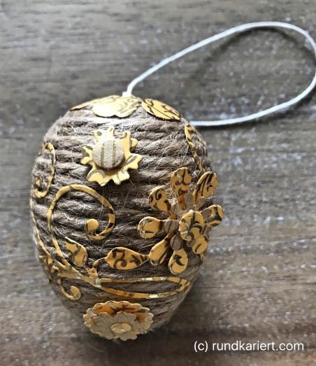 Ei Ostern Paketschnur Ornamente Blüten geklebt