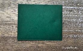 Weihnachtlicher Türkranz Anleitung diy basteln Origami Kranz falten Art rundkariert Tannengrün falten